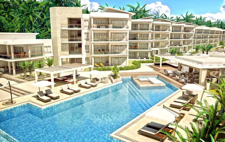 Общий вид люксовых апартаментов Playa Coral на первой линии у моря в Пунта-Кане (Доминиканская республика)